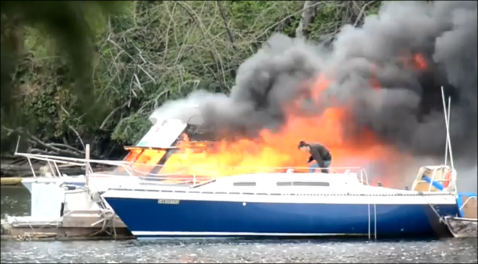 Sailboat owner trying to save it from fire