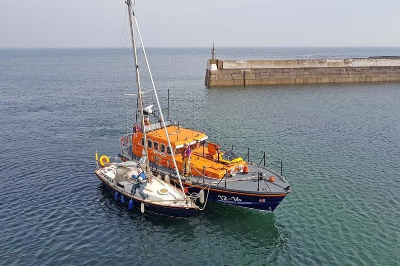 Yacht owner forced to call for lifeboat rescue after getting stuck in a harbour