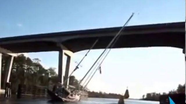 Sailing a Boat Under a Low Bridge