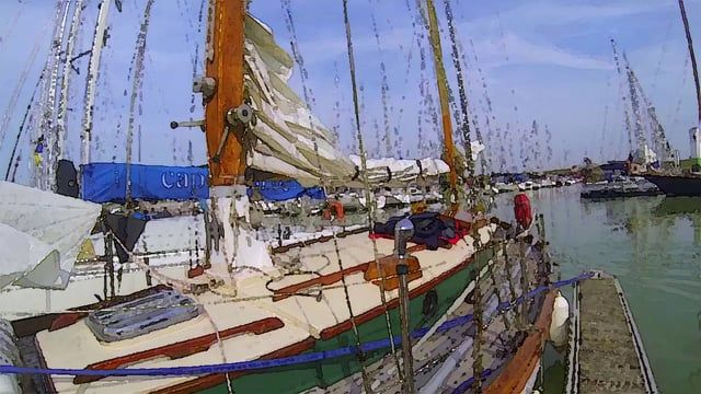 Delivering a vintage wooden boat along the coast into Belgium
