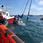Sailboat sinks after collision with moored boat