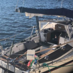 Two-man crew of a sailboat arrested and taken by police to H...